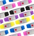 Multiple 1/2 inch silicone bands in blue, pink, black, purple, yellow with silver tone stainless Med ID tag with red caduceus