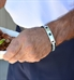 Man wearing the Ryder Medical ID Bracelet, a blend of stainless black and steel finished links, affixed tag, black caduceus