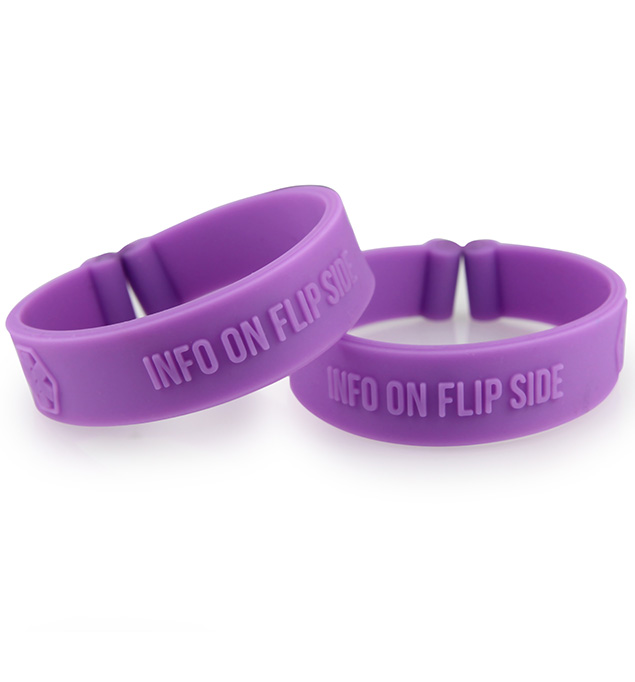 """Two purple silicone bands with debossed medical symbols and the words, """"Info on flip side"""" without tags"""