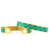 Yellow gold tone zig zag pattern runs across a green background. The med ID symbol is placed on either end.