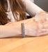 Woman wearing silver silicone Medical ID Bracelet