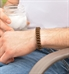 Man wearing brown silicone medical ID bracelet with silver lobster clasps