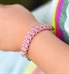 Little girl wearing pink woven paracord medical ID bracelet