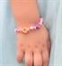 Little girl wearing Lanni Rainbow Heart Stretch Bracelet