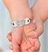 Little girl showing custom laser engraved medical ID bracelet with decorative edge