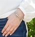 Interchangeable multi strand bracelet: Sterling silver, crystal, and rose gold tone beads shown on wrist