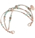 Interchangeable multi strand bracelet: Sterling silver, crystal, and rose gold tone beads shown on white background