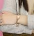 rose gold tone gardenia medical ID tag shown on wrist
