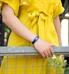 Woman in yellow dress wearing blue Urban Medical Alert Bracelet