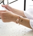 Woman wearing Avery SmartSize Medical ID Bracelet with copper tone leather band and adjustable chain with another bracelet