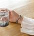 Woman showing silver tone adjustable clasp on Bella SmartSize Medical ID Bracelet