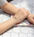 Woman wearing rose gold and silver medical alert bracelet with beads