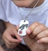 Boy wearing a Safe T Rex Medical ID Dog Tag, a stainless tag that features a roaring T-Rex and red caduceus, on a ball chain