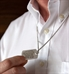 Man showing custom engraved medical ID dog tag necklace with laser engraving