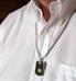 Man wearing black medical ID dog tag necklace