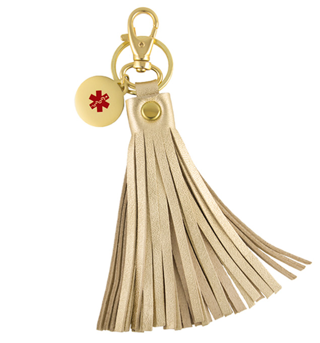"""Harper Med ID Purse Tassel. A 6"""" long metallic gold leather tassel, gold tone stainless grommet, keyring, med ID charm, clasp"""