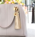 """Purse with Harper Med ID Purse Tassel. 6"""" Metallic gold leather, gold tone stainless grommet, keyring, med ID charm, clasp"""