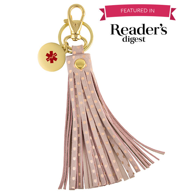 """6"""" pink Sloan Med ID Purse Tassel with gold dots, circle charm, key ring, lobster clasp, words, """"Featured in Reader's Digest"""""""