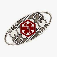 Stainless steel medical ID tag with a dark floral pattern and red medical symbol.