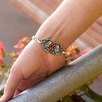 Woman wearing Guardian Angel Medical ID Tag on an LH bracelet. Stainless ID tag has angel wings, antique finish, red caduceus