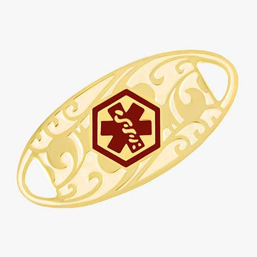 Oval-shaped gold-tone stainless steel medical alert tag with red medical symbol and scrolling filigree pattern