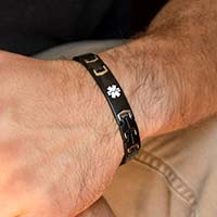 Man wearing Black Stealth Medical ID Bracelet. Stainless bracelet with matte black finish, white caduceus, stainless accents