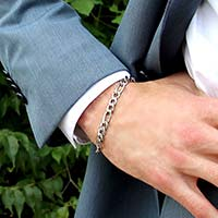 """Man wearing the Napoli Medical ID Bracelet with a silver-tone stainless chain with 3/8"""" x 1/4"""" and 5/8"""" x 1/4"""" links"""