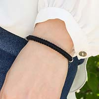 Woman wearing Black Macrame Medical ID Bracelet. Good view of the macrame band. Pairs with any interchangeable med ID tag