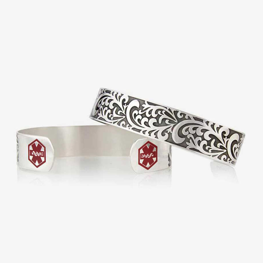 Front, back of Filigree Medical Alert Cuff. Silver tone stainless cuff. Intricately scrolled design and red caduceus each end