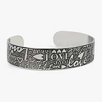 """Front of Love Medical ID Cuff with embossed hearts, XO hugs and kisses, the word, """"LOVE,"""" in varied prints and scripts"""