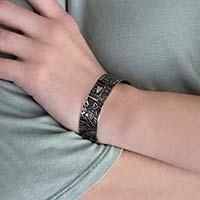 """Woman wearing stainless steel cuff medical alert bracelet with """"love"""" inscriptions"""