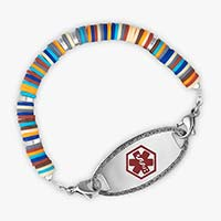 Overhead view of medical ID bracelet for boys, with colorful disc-shaped beads and oval ID tag with red caduceus.