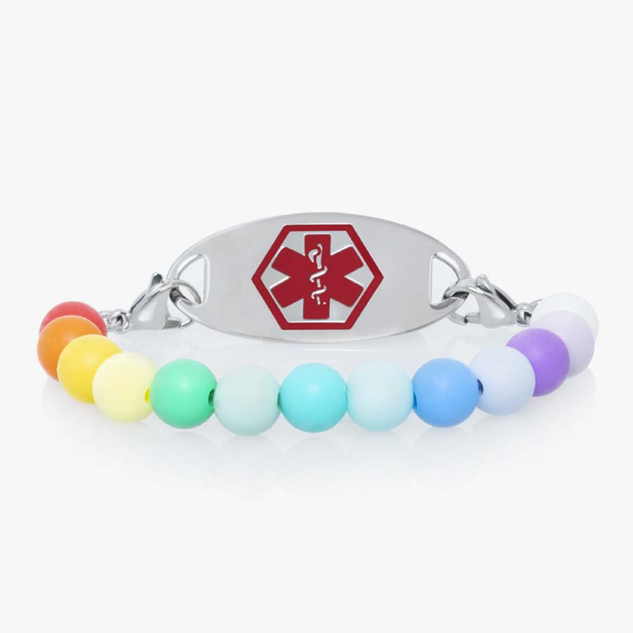 Little girls' medical ID bracelet with rainbow silicone beads and medical ID tag with bold red symbol.