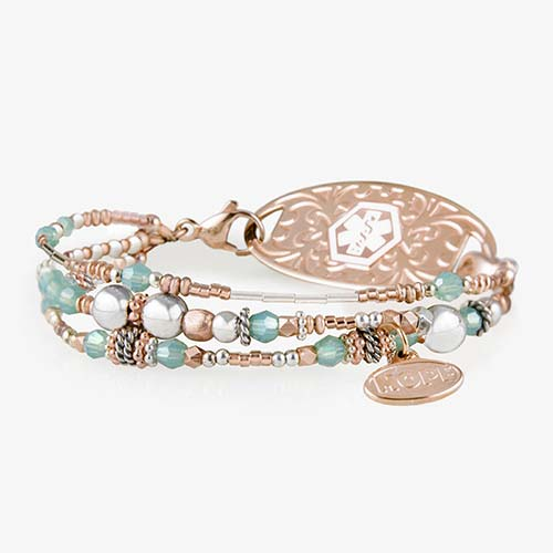 Interchangeable multi strand bracelet: Sterling silver, crystal, and rose gold tone beads attached to rose gold tone medical ID tag
