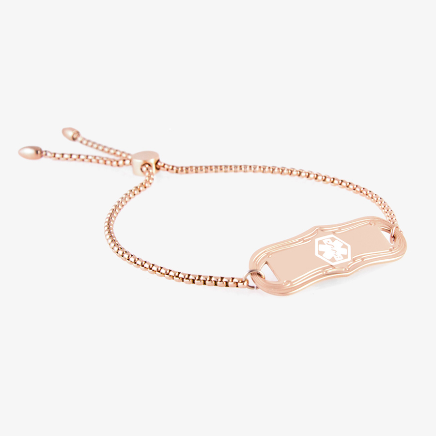 Easily adjustable rose tone chain with sliding clasp and matching tag with white med ID symbol.