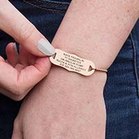 Woman showing engraving on the back of the stainless slip-on SmartFit Medical ID Bracelet in Rose Gold Tone with SmartBead