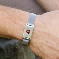 Maan wearing the silver-tone stainless Urban Medical Alert bracelet with mesh chain and affixed ID tag with red caduceus