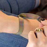 Woman opening magnetic clasp of magic finish medical alert bracelet