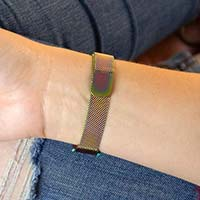 Woman showing magic finish medical ID bracelet with magnetic clasp