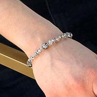Woman wearing silver beaded crystal stretch medical ID bracelet