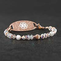 Krista Stretch Bracelet with rose gold beads and crystals and a rose gold tag with white medical ID symbol on slate