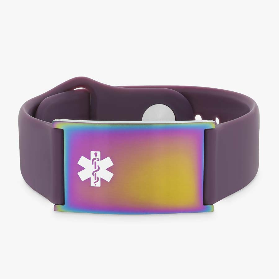 Low front angle of grape silicone band with adjustable strap and a multi colored magic tag and white caduceus symbol.