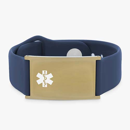 Low front angle of navy silicone band with adjustable strap and a yellow gold tag and white caduceus symbol.