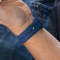 Close-up of pin-tuck watch band closure on navy blue silicone bracelet.