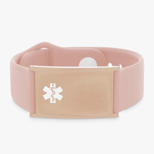 Low front angle of pink silicone band with adjustable strap and a rose gold tag and white caduceus symbol.