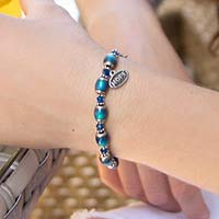 Color-changing mood beads with stainless steel and Blue Swarovski crystal accents interchangeable ID bracelet on wrist
