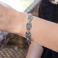 Woman wearing Medical ID bracelet. Shows 4 of 6 links of scroll work pattern. Matches with any interchangeable LH med ID tag