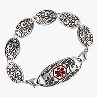 """Antique Gate Medical ID bracelet. Six 3/4"""" by 1/2"""" links with detailed, black-filled scroll work pattern. On white background"""