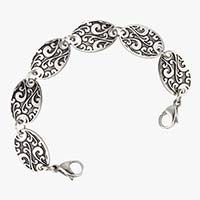 """Med ID bracelet with six 3/4"""" by 1/2"""" links with detailed, black-filled scroll work pattern. Silver tone stainless med ID tag"""