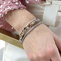 Woman wearing gold and silver beaded medical alert bracelet